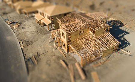 Aerial View of New Homes Construction Site with Tilt-Shift Blur. Archivio Fotografico