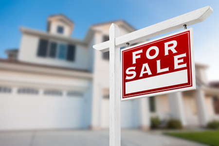 Home For Sale Real Estate Sign in Front of New House. Stockfoto