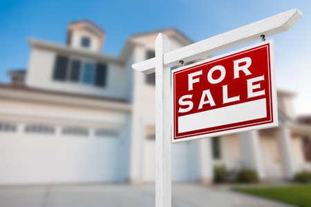 Home For Sale Real Estate Sign in Front of New House. Reklamní fotografie