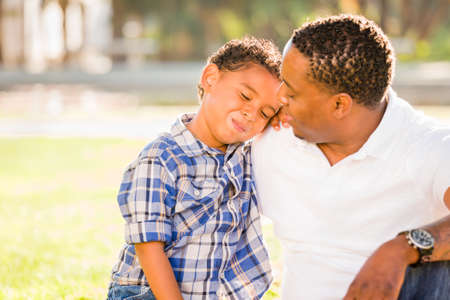Happy African American Father and Mixed Race Son Playing At The Park.