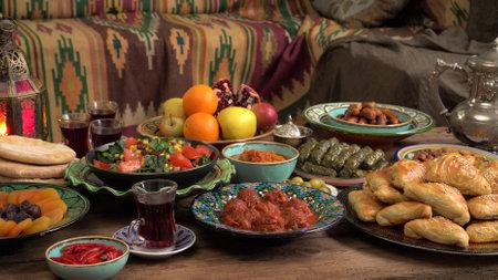 Festive traditional Middle Eastern Muslim Halal food on the table. Celebration of Eid al-Adha or the Feast of Sacrifice