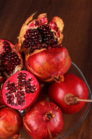 orginal: Many Pomegranate on the wood and half