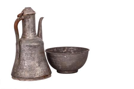 pewter mug: Antique copper jug on the white background Stock Photo