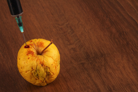 surgical needle: Hormone Apple on the Wood