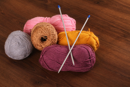 woolen: Woolen Colors on the Wood Stock Photo
