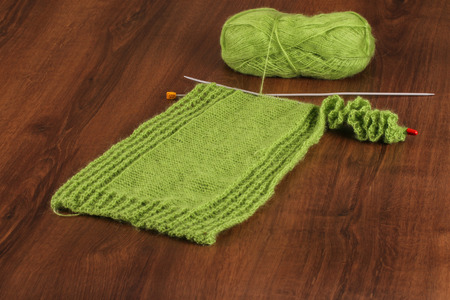 woolen: Woolen Green on the Wood Stock Photo