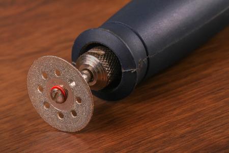 metal cutting: The Metal cutting wheel  on the wood