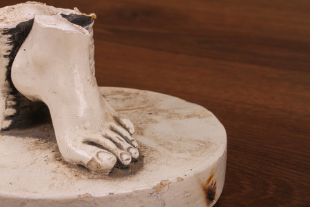 human toe: This is a value of intangible artwork. There is a broken fingers from plaster.