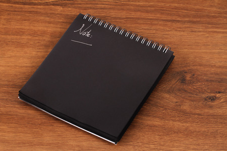 book binding: This is a black notepad for reminder or notes. Stock Photo
