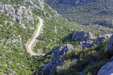 thoroughfare: The road of middle in the mountains in the Turkey. This is a classic view of Mediterranean Sea. Stock Photo