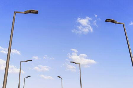 Electric lamp with blue sky and clouds. Stockfoto