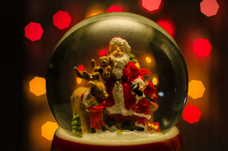 Glass snow ball red background xmas santa