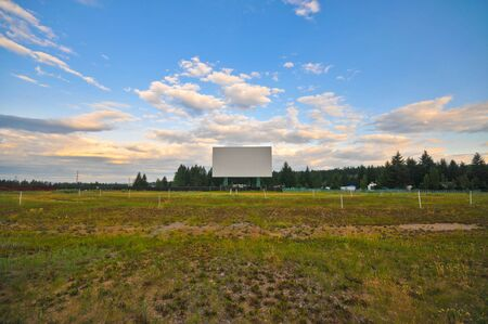 Abandened drive in screen with sky and grass Stock Photo - 5457766