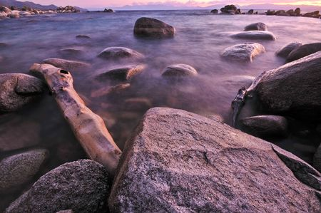 Rocks and boulder an the shore of a lake Stock Photo - 5467258