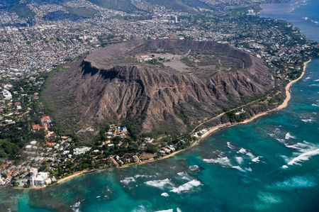 crater: Diamond Head creater from an airplane with ocean.