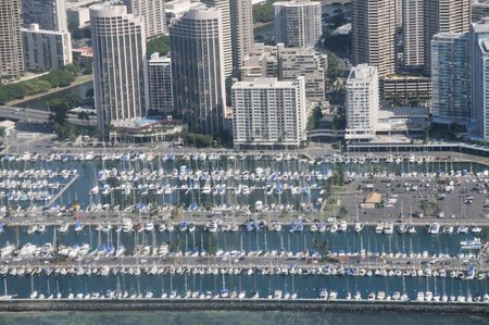 Arial view of a marina with skyscrapers in the background.