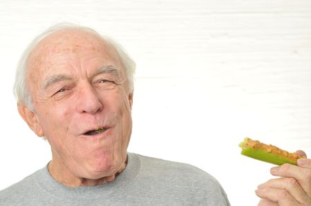 A happy man eating peanutbutter as his diet.