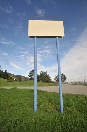hold up: Two long poles hold up a blank sign