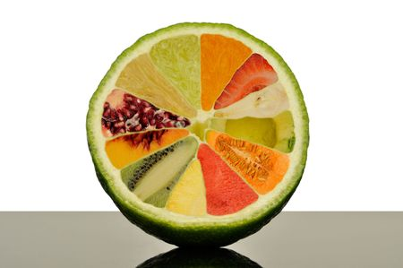 Half of a lime with eleven other fruit slices inside. photo