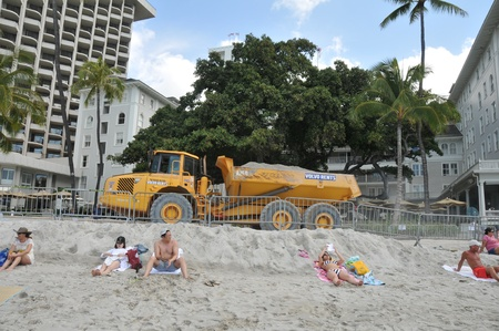 sun bathers: Beach goers seem to ignore the Waikiki Beach Maintenance Project which is restoring the beach to its mid-1980 Editorial