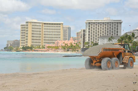 restoring: A dump trunk is part of the Waikiki Beach Maintenance Project which is restoring the beach to its mid-1980