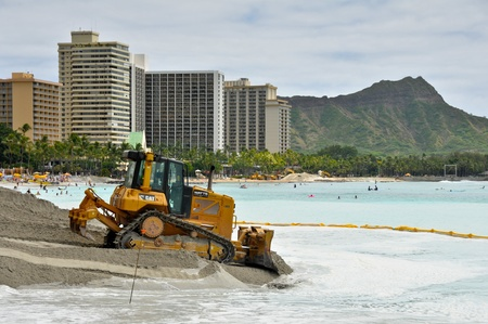 restoring: Heavy equipment is part of the Waikiki Beach Maintenance Project which is restoring the beach to its mid-1980