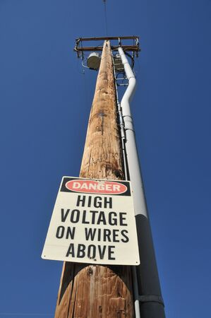 Telephone pole with a high voltage sign 版權商用圖片