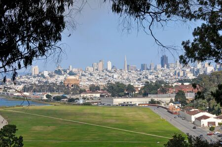 Crissy Field grassy area near Palace of Fine Arts with San Francisco skyline.