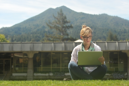 college campus: Female beautiful student on campus