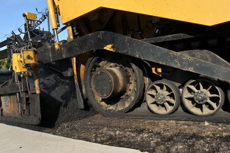 asphalt paving: An asphalt paving machine is used to pave a city street