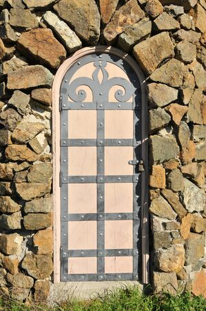 guard house: Stone wall with a guard house with ornate metalwork  Stock Photo