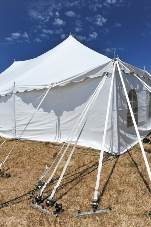 Many straps support a tent in a field