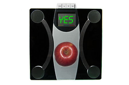Scale reads YES for the apple on it - a good choice of food for dieting  photo