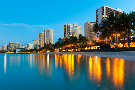 Reflections of buildings at Waikiki in the water  photo