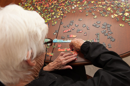 A thousand piece jigsaw puzzle put together by a white haired elderly retired white woman
