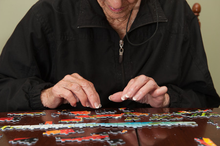assisted living: A thousand piece jigsaw puzzle put together by a white haired elderly retired white woman