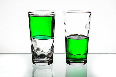 optimistic: Half empty or half full - pessimism or optimism Stock Photo