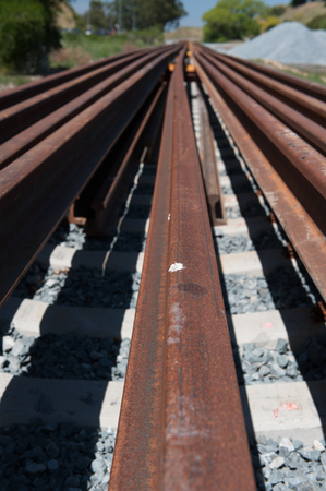 mainline: Multiple rails wait for installation on a train track