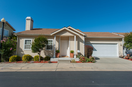 Single family house with two levels and a short driveway.