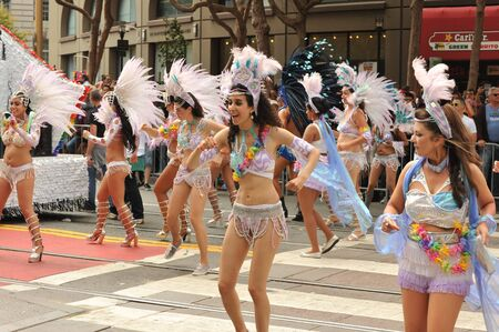 sf: SAN FRANCISCO - JUNE 28: Paraders on Market Street in the SF Pride Parade enjoy the day on June 28, 2015