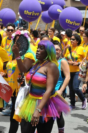 homosexuals: SAN FRANCISCO - JUNE 28: Paraders on Market Street in the SF Pride Parade enjoy the day on June 28, 2015