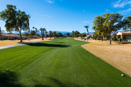 Fairway of a golf course with brow grass in the rough area