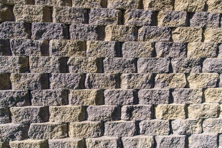 concrete form: Pattern created by bricks of concrete form a wall. Stock Photo