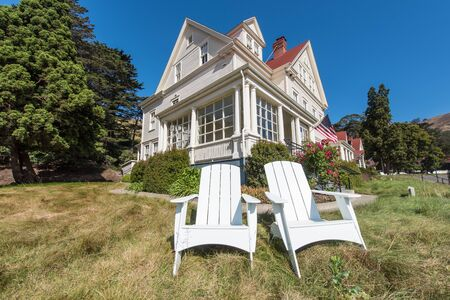 Two chairs in front of a  Fort Baker building. Stock Photo