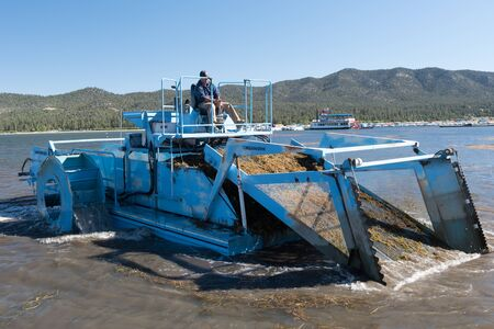 Big Bear Lake, California, June 17, 2016 � An aquatic weed harvester removes weeds from the lake in preparation for the Big Bear Triathlon June 18, 2016