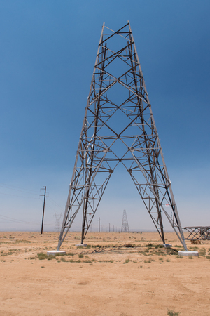 electrical tower: A electrical tower pylon under construction in the desert