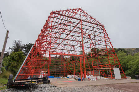 Barn structure of iron without walls during construction. Stock Photo