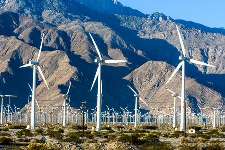 Turbines near Palm Springs with three blades on a sunny day.