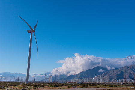 Many wind machines in the desert with cloudy skys Stock Photo