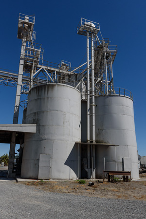 Processing plant with many towers and walkways and pipes Stock Photo